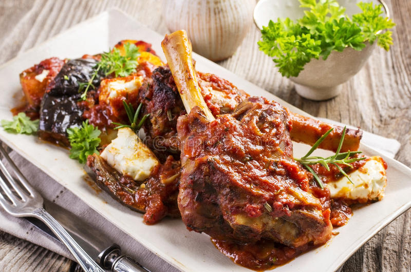 Braised Lamb Knuckle. As closeup on a beige plate stock photos
