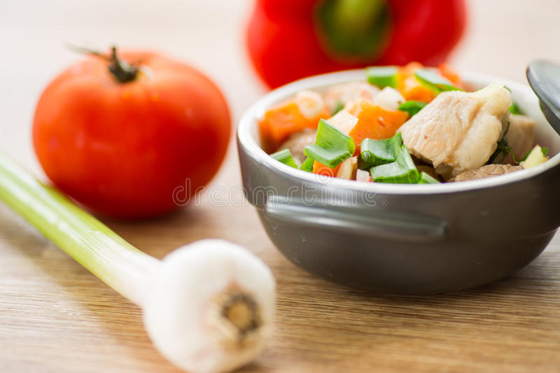 Braised pork with vegetables. Pork stew with vegetables in a pot stock photo