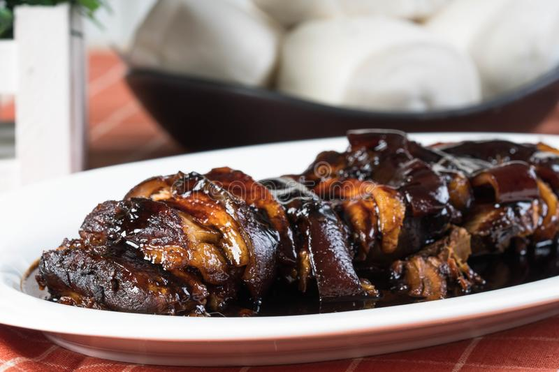 Braised sweet soy pork belly with plain steamed buns stock photo