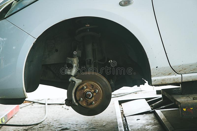 Brake and detail of the wheel hub. car brake pads.disc brakes on cars in process of new tires replacement. In the garage or auto repair service center, as royalty free stock photo