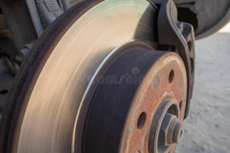 Brake disc and car caliper. The picture with the wheel removed for tire royalty free stock photos