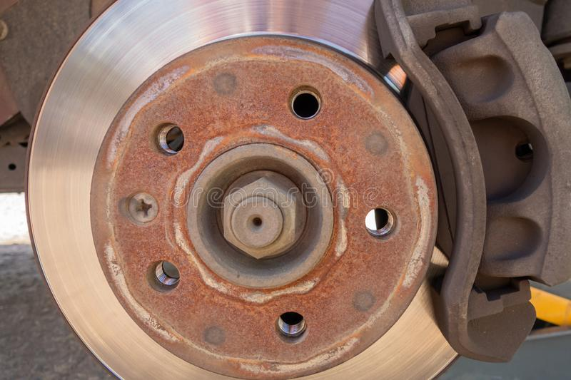 Brake disc and car caliper. The picture with the wheel removed for tire. Transportation, vehicle, safety, close, metal, technology, power, ancient, steel stock photography
