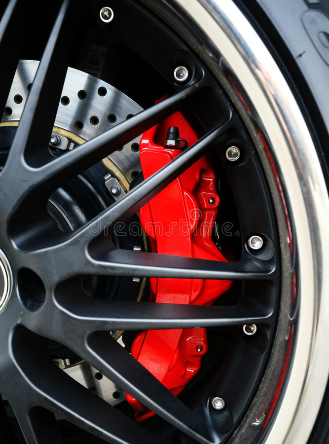 Brake Disc and Red Calliper. Racing Car wheel close up royalty free stock images