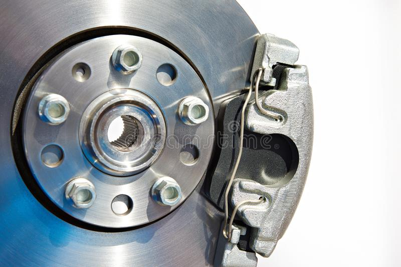Brake disc and support with pads. Isolated royalty free stock photography