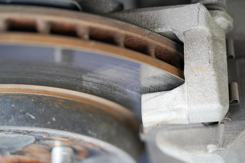 Brake disc and used brake pads. Of the wheel stock image
