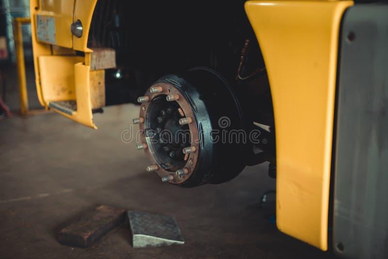 Brake disc without wheels. Car or vehicle brake part at garage, car brake disc without wheels closeup royalty free stock photos