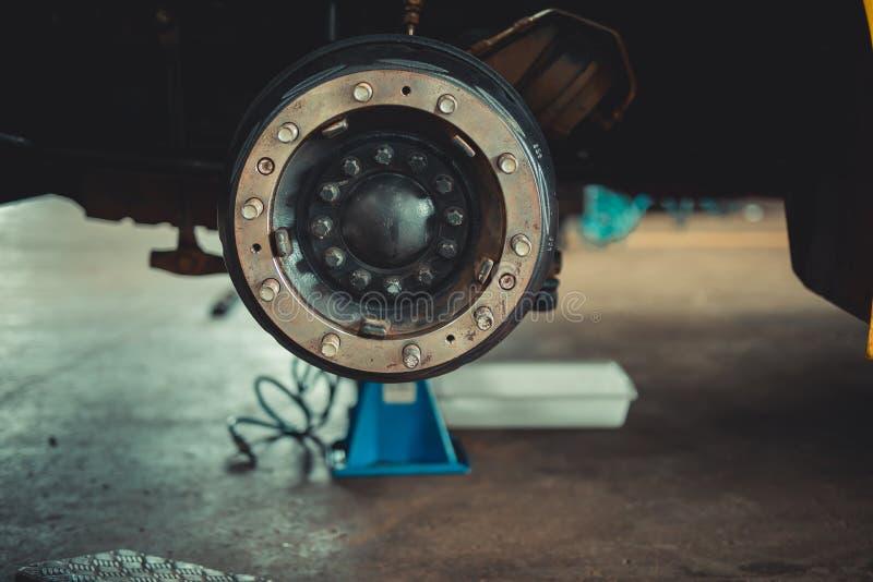 Brake disc without wheels. Car or vehicle brake part at garage, car brake disc without wheels closeup royalty free stock images