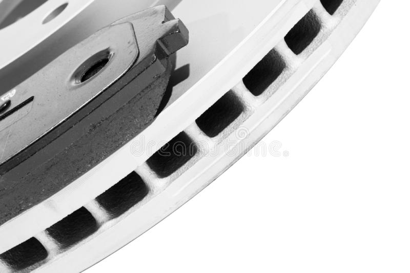 Brake discs and brake pads isolated on white background. Auto parts. Brake disc rotor isolated on white. Braking disk. Car part. C stock photography