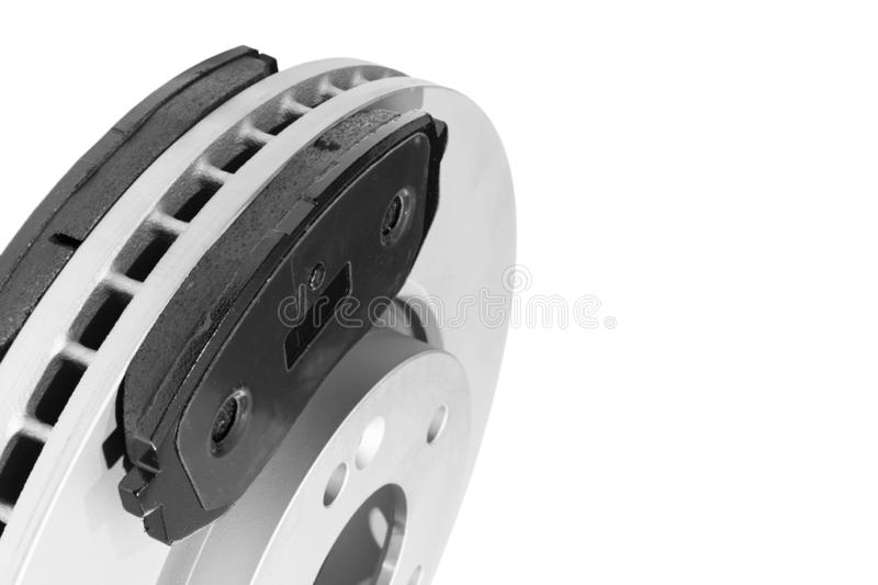 Brake discs and brake pads isolated on white background. Auto parts. Brake disc rotor isolated on white. Braking disk. Car part. C. Ar detailing. Spare parts stock images