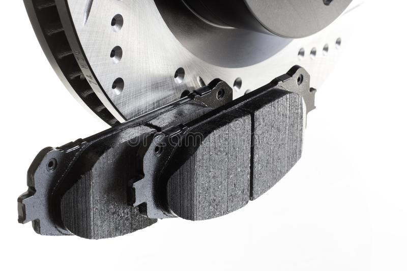 Brake discs and pads on a white background. Auto shop royalty free stock photography