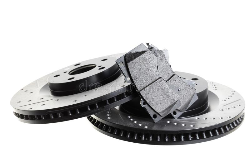 Brake discs and pads on a white background. Auto shop stock photo