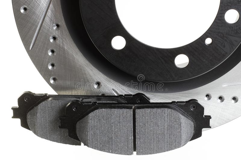 Brake discs and pads on a white background. Auto shop royalty free stock photo