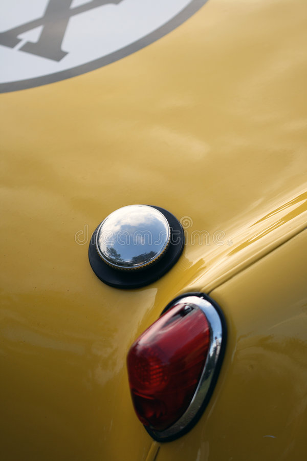 Brake light and gas filler cap detail on British sports car. Rear brake light detail on British sports car royalty free stock image