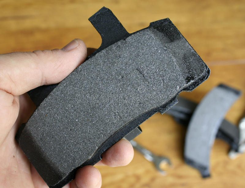 Brake pad. Hand holding a brake pad stock photo