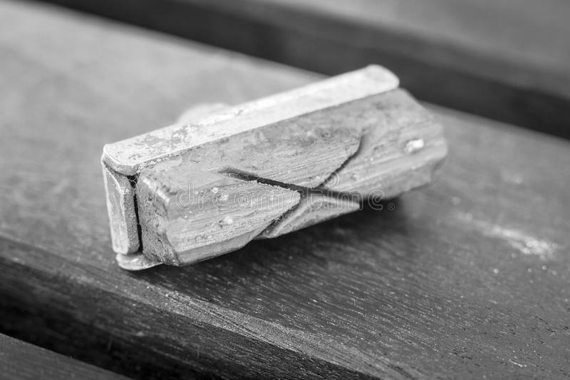 Brake pad. A black and white image of a worn bicycle brake pad royalty free stock photography