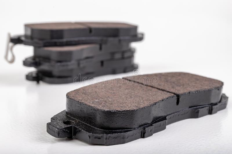 Brake pad for a passenger car. New spare parts for car repairs stock images