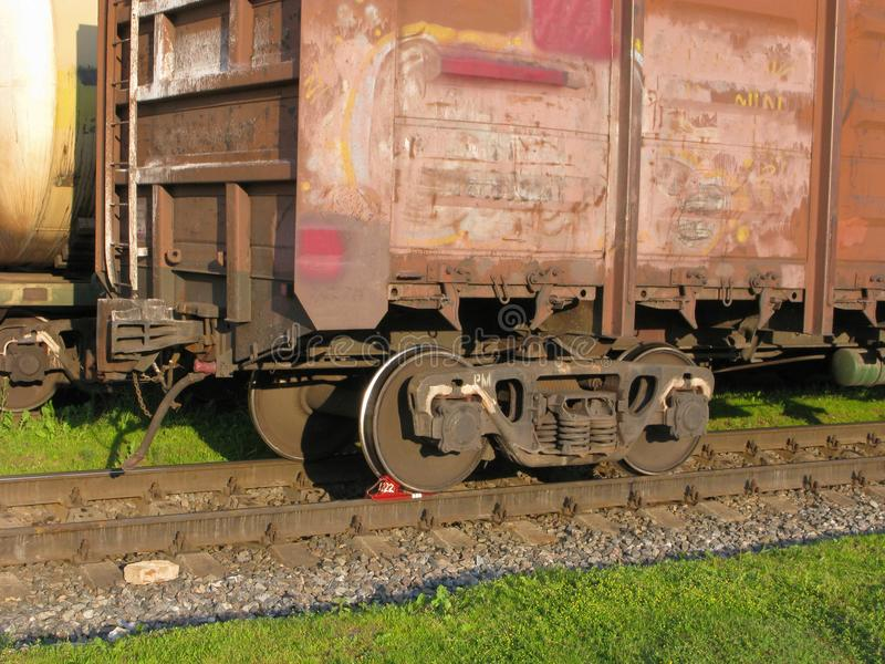 Brake pad under wheel, railway cargo container. Red brake pad under wheel of a railway cargo container. Freight wagons is at the railroad junction stock images