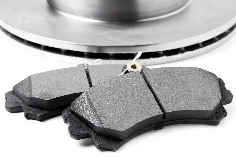 Brake pads and brake discs on white background. Auto parts stock images