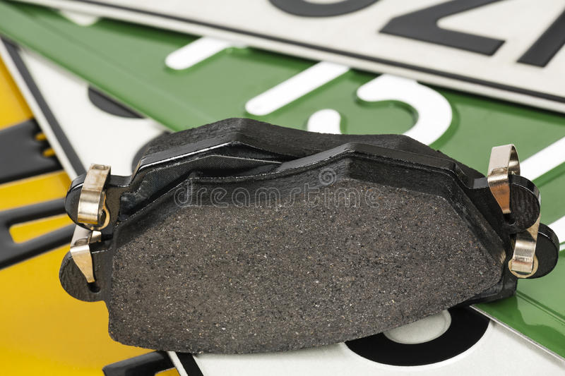 Brake pads and license plates royalty free stock image