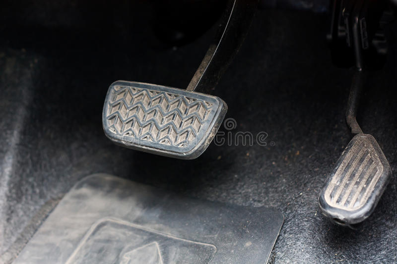 Brake pedal and accelerator. Of the car stock image