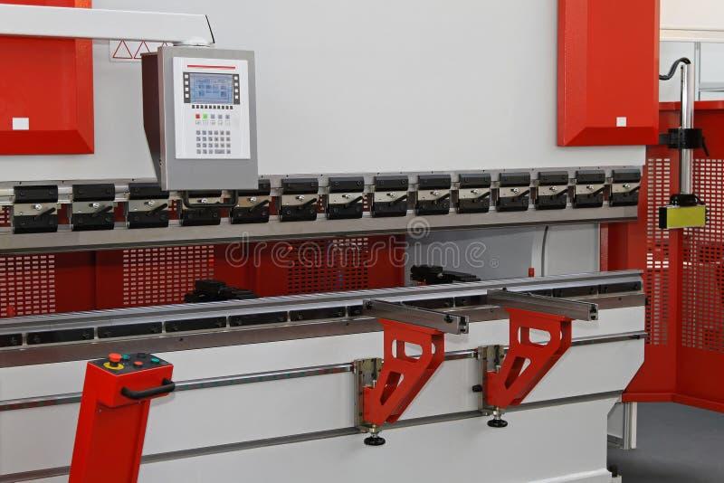 Press brake. Brake press machine for bending metal sheets stock photos