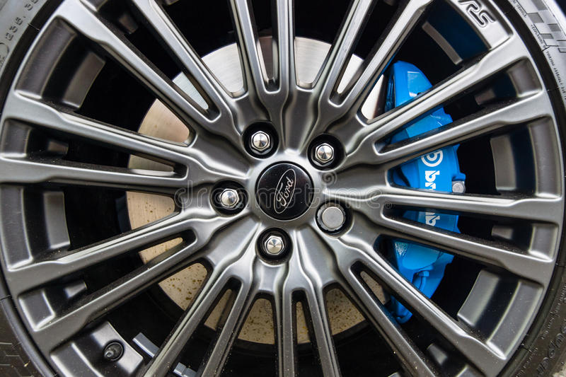 The brake system and wheel of compact car Ford Focus RS (third generation), close-up. royalty free stock images