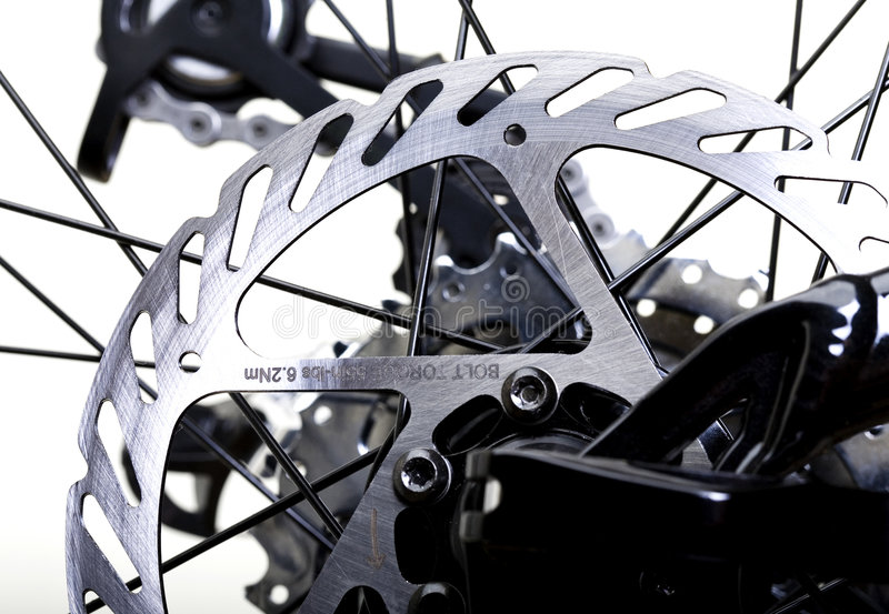 Brakes. Hydraulic Rear Brakes on Bicycle - Rotor in Focus royalty free stock photos