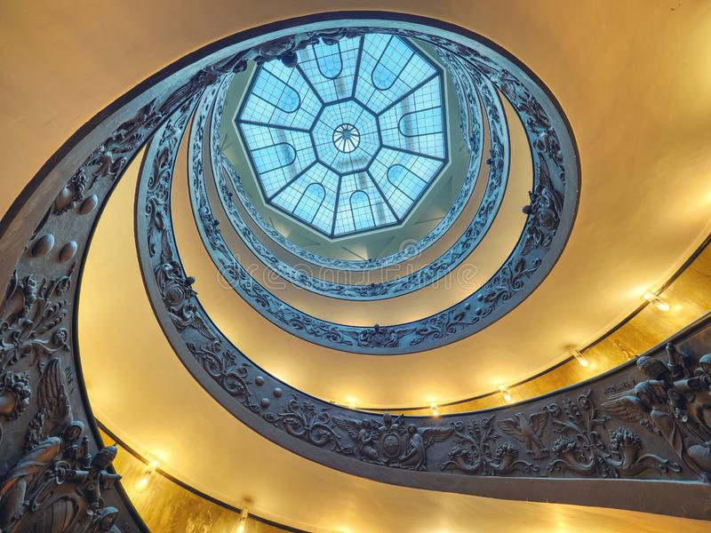 The Bramante Staircase is a double helix, having two staircases allowing people to ascend without meeting people descending.  stock image
