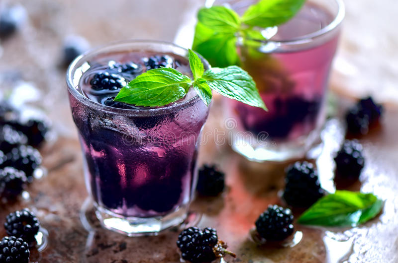 Bramble drink. Bramble or blackberry cool summer drink or alcoholic coctail royalty free stock photo