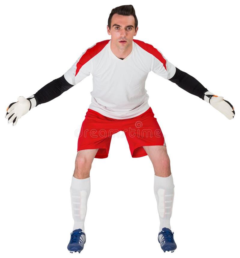 Bramkarz w białym przygotowywającym save zdjęcie royalty free