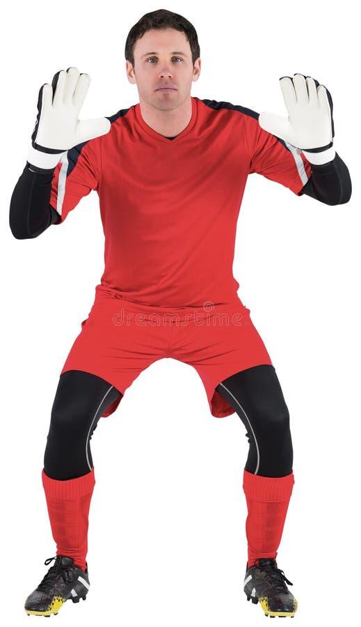 Bramkarz w czerwonym przygotowywającym chwyt obraz stock
