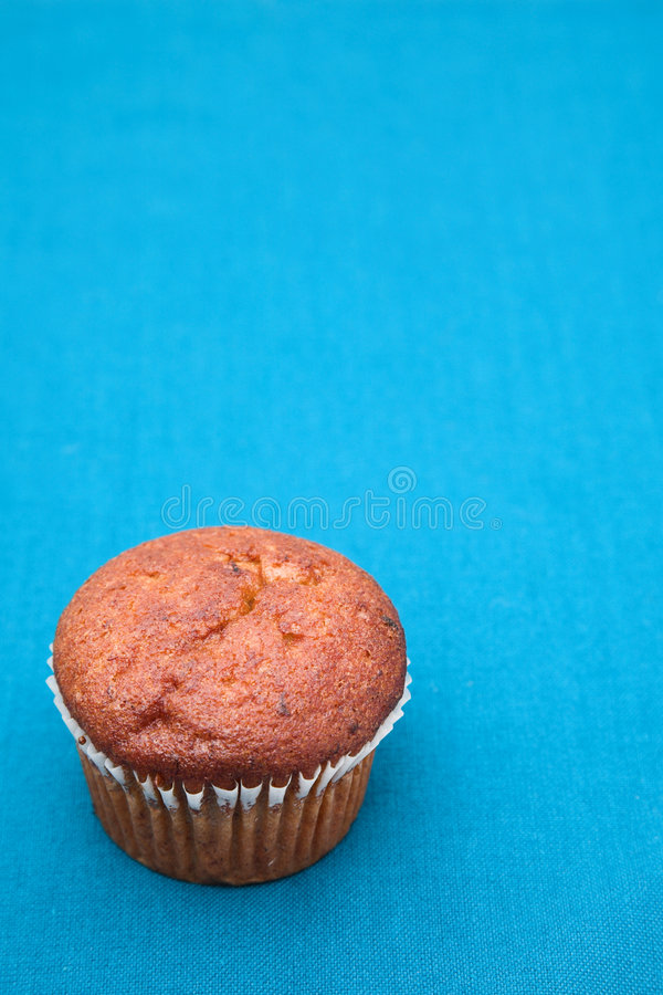 Bran and Banana Muffin on blue background