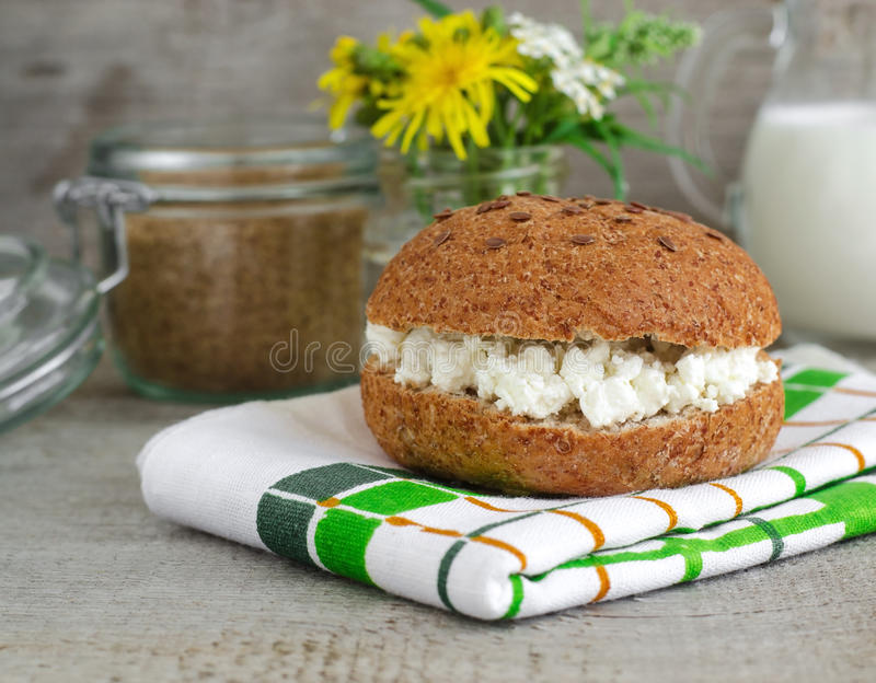 Bran bun with cottage cheese stock images
