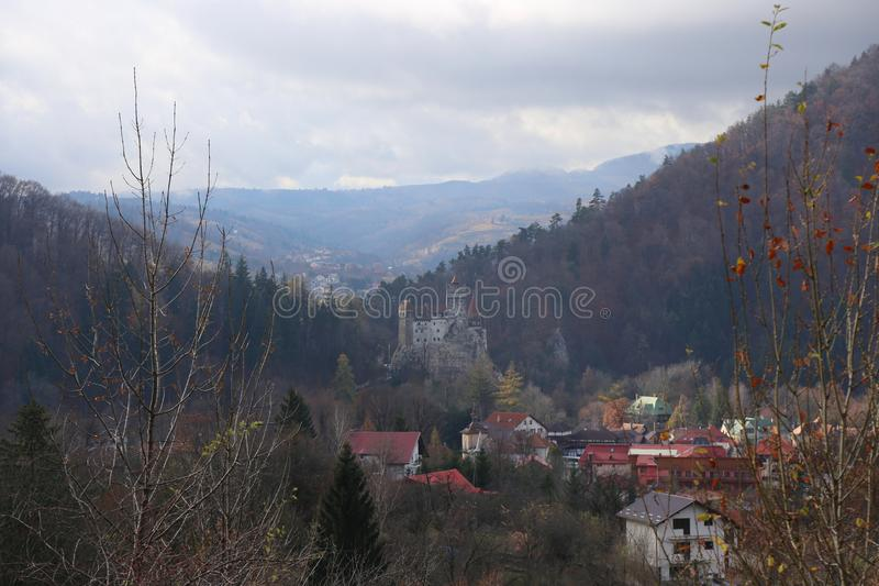 Bran castle in the cloudy weather. View from the valley royalty free stock images