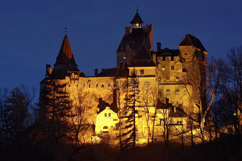 Bran Castle, medieval fortress, lighted at night - landmark attraction in Romania. Bran Castle, a medieval fortress, lighted at night - landmark attraction in royalty free stock images