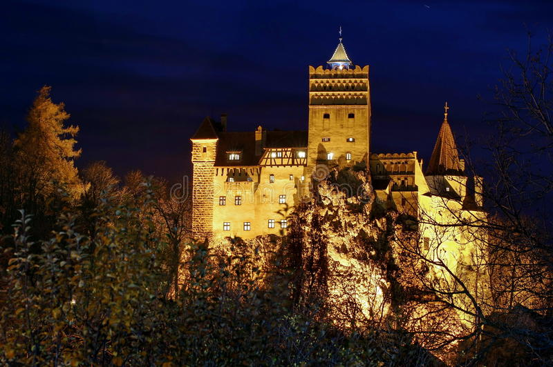 Bran Castle, medieval fortress, lighted at night - landmark attraction in Romania. Bran Castle, a medieval fortress, lighted at night - landmark attraction in royalty free stock image