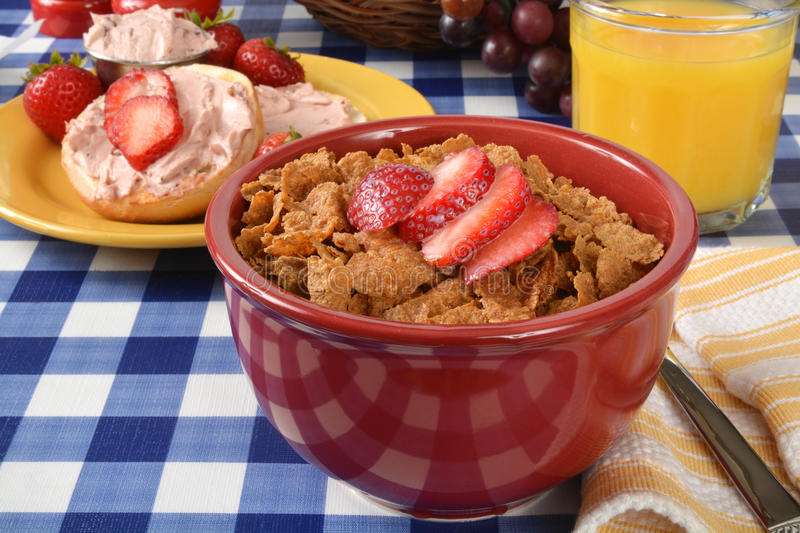 Bran flakes cereal with strawberries royalty free stock image