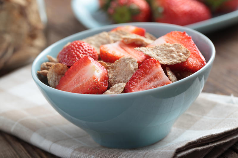 Bran flakes with strawberry royalty free stock image