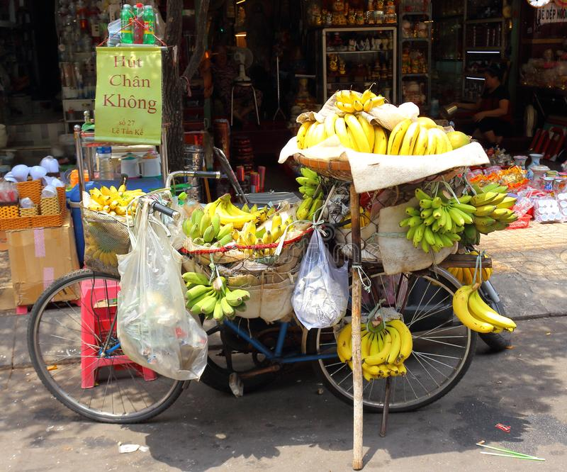 Branch of banana for sale in the street market stock photography