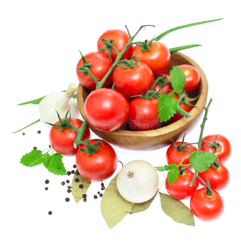Download The Branch Of Cherry Tomatoes In A Wooden Bowl Stock Photo - Image: 24863372