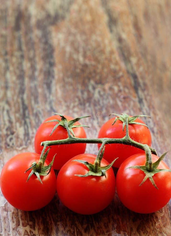 Branch Of Fresh Cherry Tomatoes Stock Photo