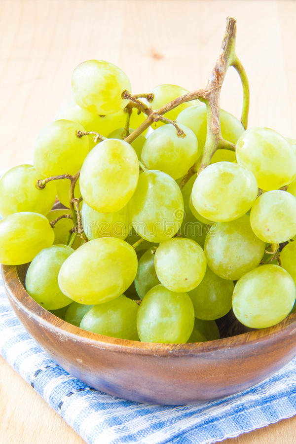 Download Branch Of Green Fresh Grapes In A Wooden Bowl Stock Photo - Image: 30826292