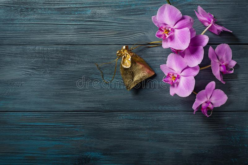 Purple Orchid and a gift bag stock photography