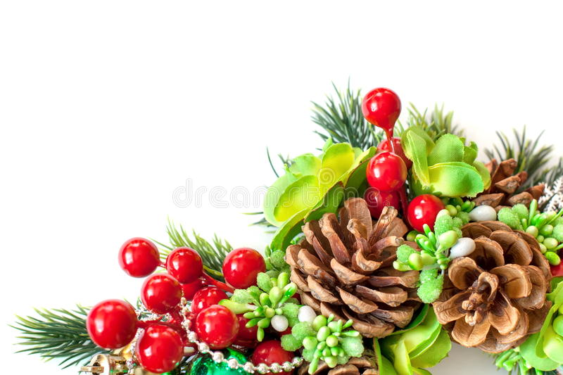 Branch of spruce with cones, berries and flowers stock photo