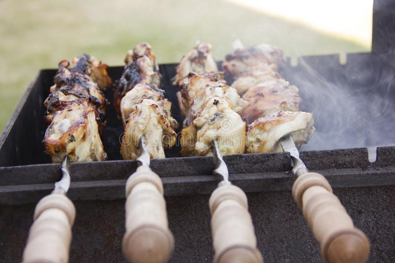 The branches are burning in the grill. The fire in the grill. Cooking on charcoal royalty free stock image