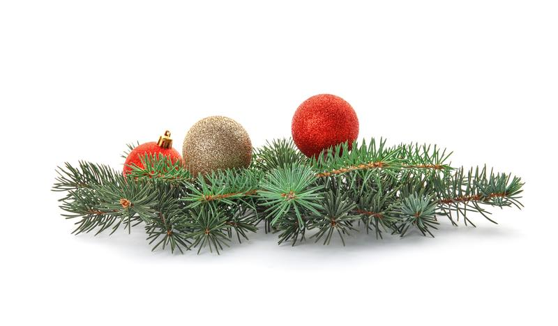 Branches of Christmas tree with decorations. On white background stock images