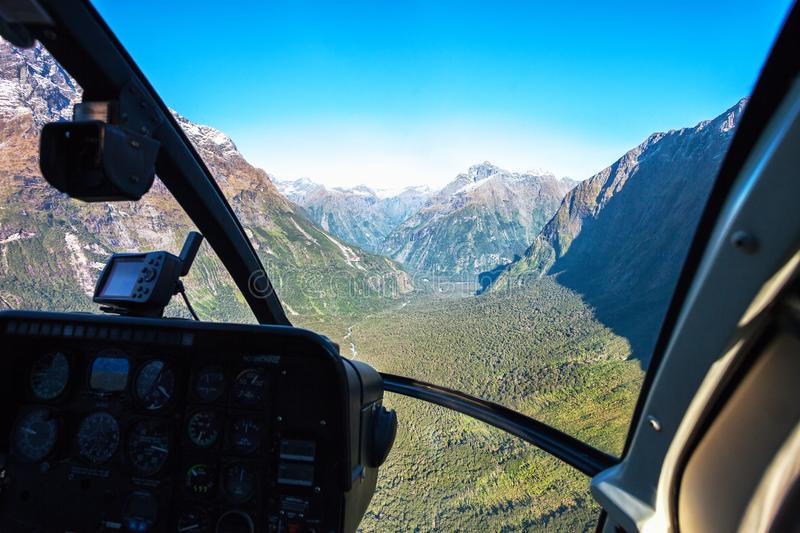 Scenic helicopter flight with view from cockpit, Milford Sound , Fiordland National Park, South Island, New Zealand.  stock images