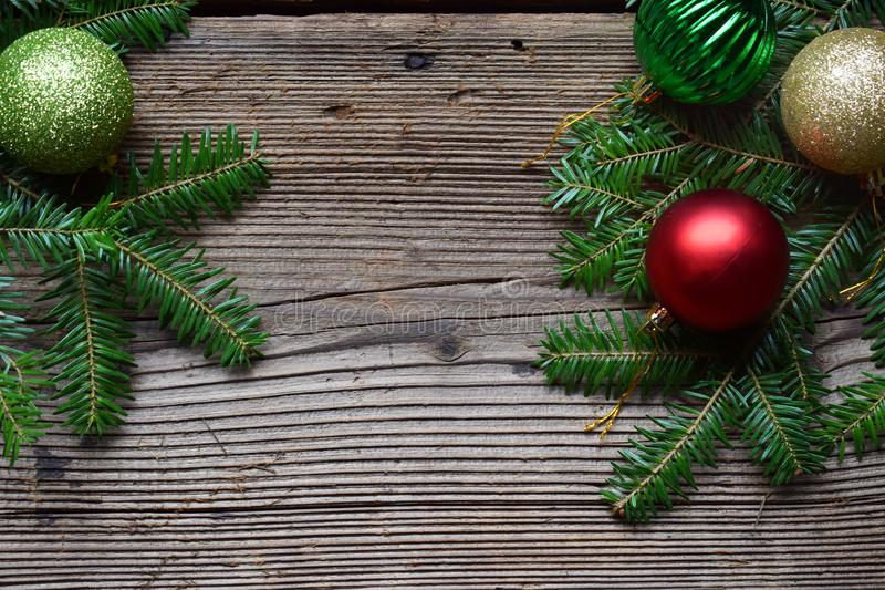 The branches of spruce on a wooden background. Happy New Year and Merry Christmas concept. Greeting card or festive background. Copy space royalty free stock photo