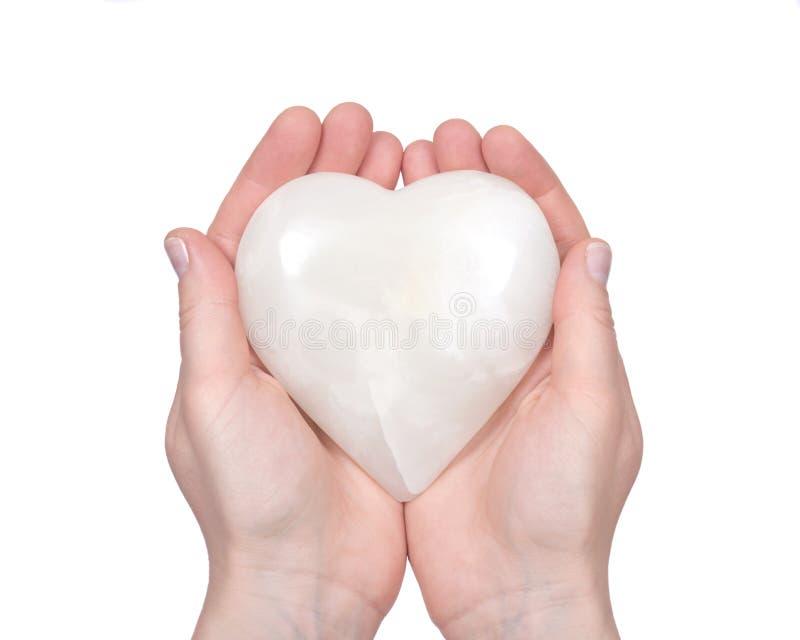Branco de creme coração cinzelado lustrado do ônix fotos de stock