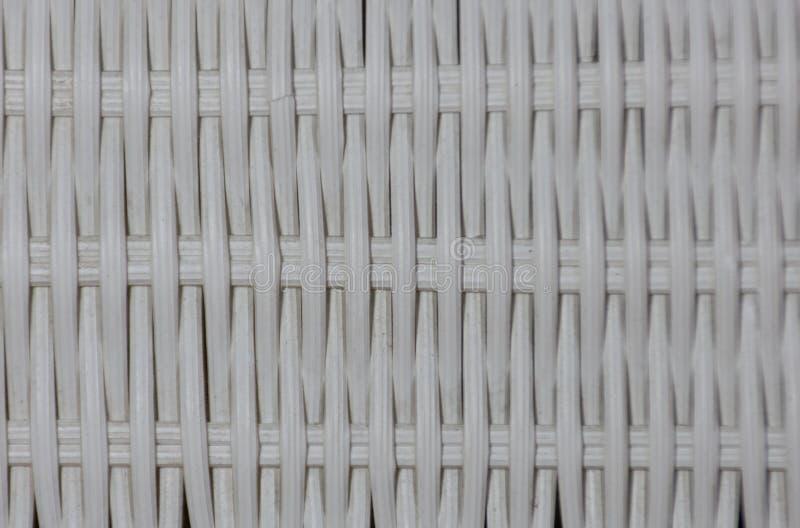 Branco plástico listrado do weave Usado como o fundo imagens de stock